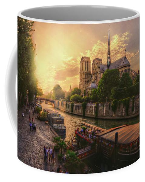 Ancient Coffee Mug featuring the photograph A View From Bridge Pont De L Archeveche, Archbishop Bridge, Infront Of Notre Dame De Paris Cathedr by Mohamed Kazzaz