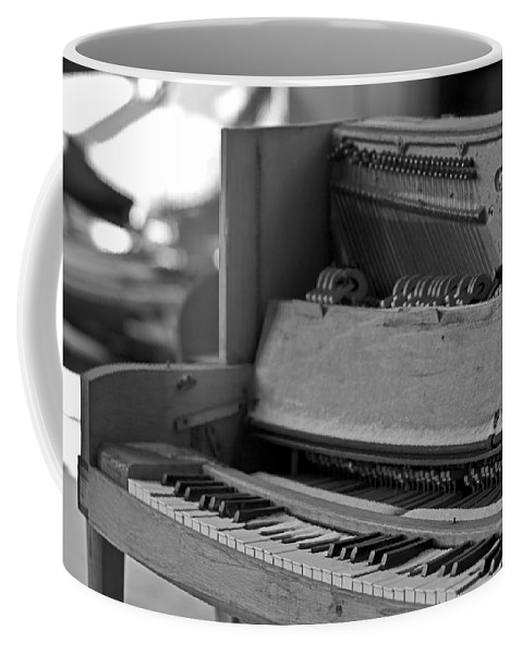 Coffee Mug featuring the photograph A Weathered Piano by Sven Brogren