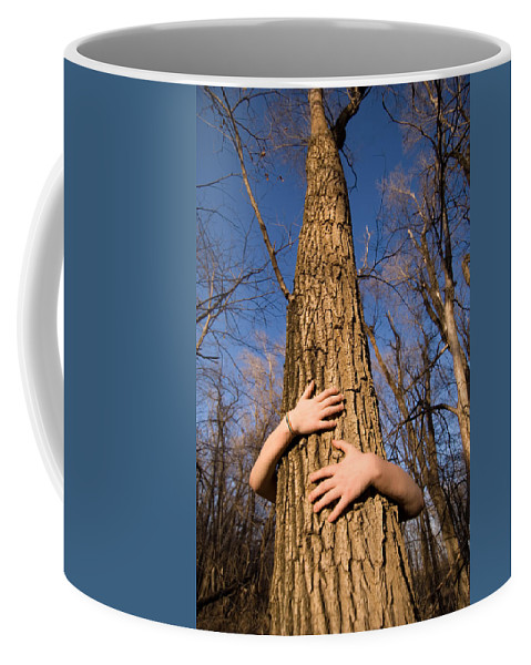Photography Coffee Mug featuring the photograph A Young Girl Wraps Her Arms by Joel Sartore