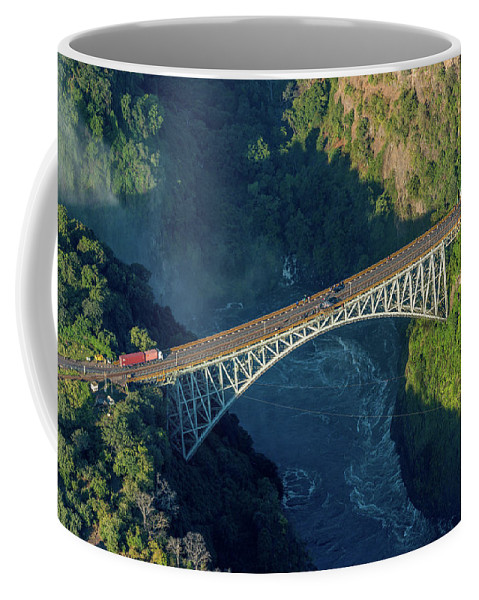 Africa Coffee Mug featuring the photograph Aerial View Of Victoria Falls Suspension Bridge by Ndp
