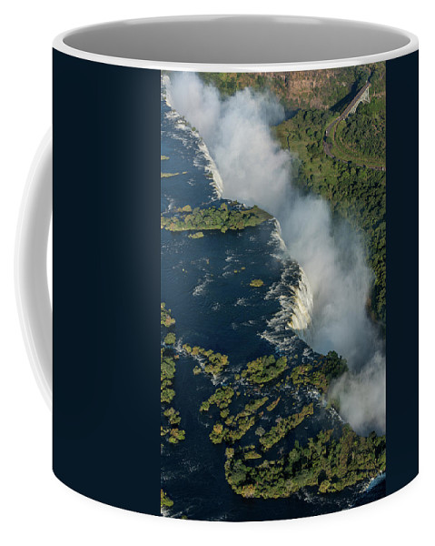 Africa Coffee Mug featuring the photograph Aerial View Of Victoria Falls With Bridge by Ndp