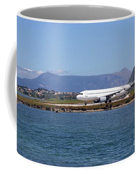Airplane Coffee Mug featuring the photograph airplane on airport Corfu island Greece by Goce Risteski