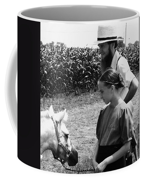 Amish Coffee Mug featuring the photograph Amish Girl And Pony by Eric Schiabor
