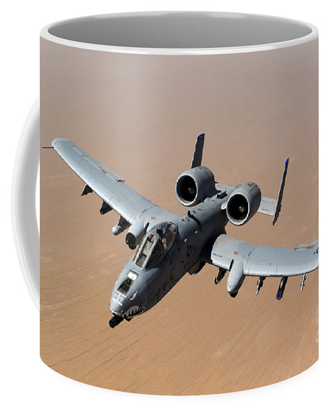 A-10 Coffee Mug featuring the photograph An A-10 Thunderbolt II Over The Skies by Stocktrek Images