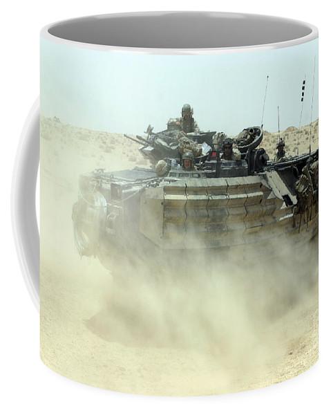 Aav Coffee Mug featuring the photograph An Amphibious Assault Vehicle Kicks by Stocktrek Images
