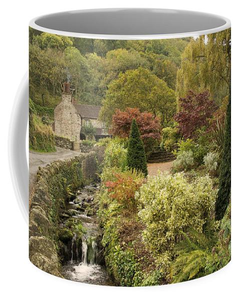 Exmoor Coffee Mug featuring the photograph An Autumn Garden by Rob Hawkins