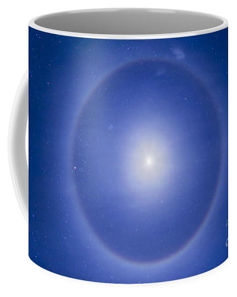 Aldebaran Coffee Mug featuring the photograph An Ice Crystal Halo Around The First by Alan Dyer