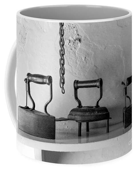 Irons Coffee Mug featuring the photograph Antique Irons by SnapHound Photography