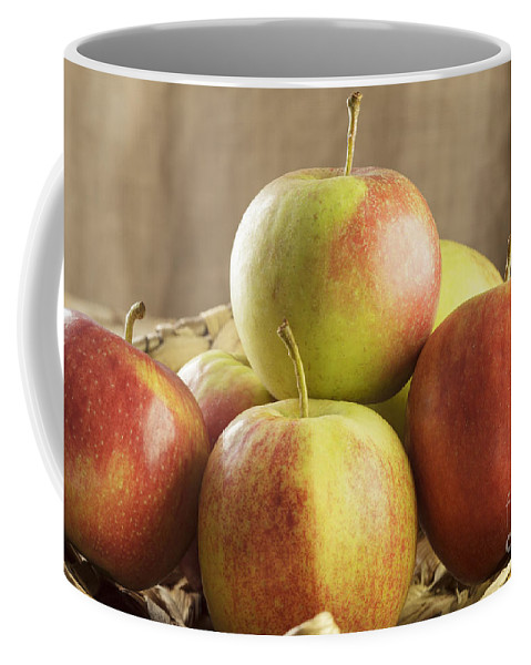 Apples Coffee Mug featuring the photograph Apples In Basket by Julie Woodhouse