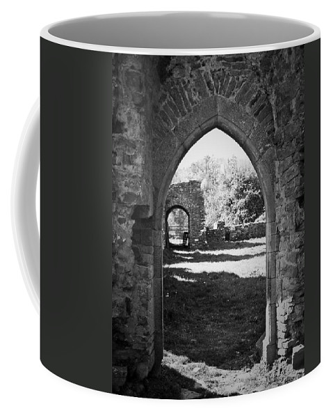 Irish Coffee Mug featuring the photograph Arched Door At Ballybeg Priory In Buttevant Ireland by Teresa Mucha