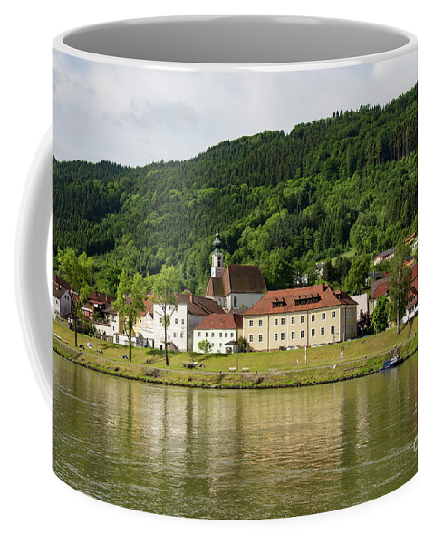 Austria Austrian Village Villages City Cities Cityscape Cityscapes Building Buildings Structure Structures Architecture Reflection Reflections Danube River Rivers Water Waterscape Waterscapes Coffee Mug featuring the photograph Austrian Village by Bob Phillips