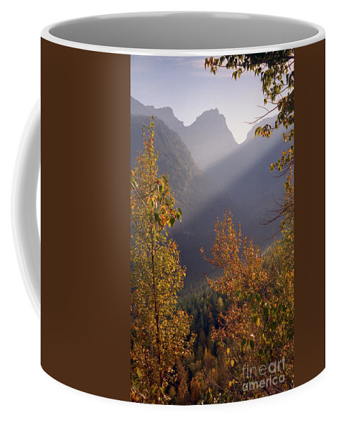 Mountains Coffee Mug featuring the photograph Autumn At Logan Pass by Richard Rizzo