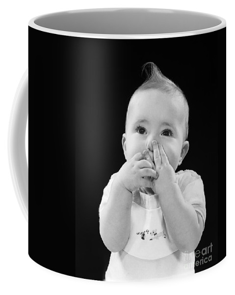1950s Coffee Mug featuring the photograph Baby Covering Mouth With Hands, C.1950s by H. Armstrong Roberts/ClassicStock