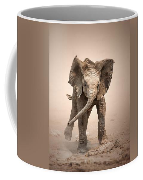 Elephant Coffee Mug featuring the photograph Baby Elephant mock charging by Johan Swanepoel