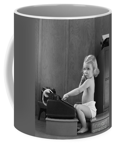 1940s Coffee Mug featuring the photograph Baby Girl With Adding Machine, C.1940s by H. Armstrong Roberts/ClassicStock