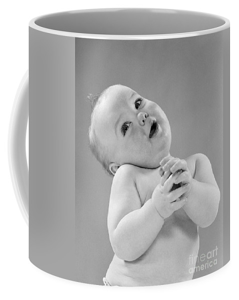 1950s Coffee Mug featuring the photograph Baby In Sentimental Pose, C.1950s by H. Armstrong Roberts/ClassicStock