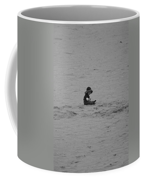 Black And White Coffee Mug featuring the photograph Baby In The Sand by Rob Hans
