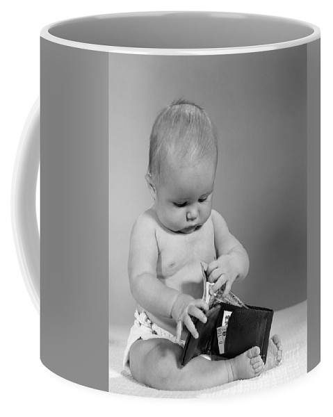 1960s Coffee Mug featuring the photograph Baby Taking Money From Wallet, C.1960s by H. Armstrong Roberts/ClassicStock