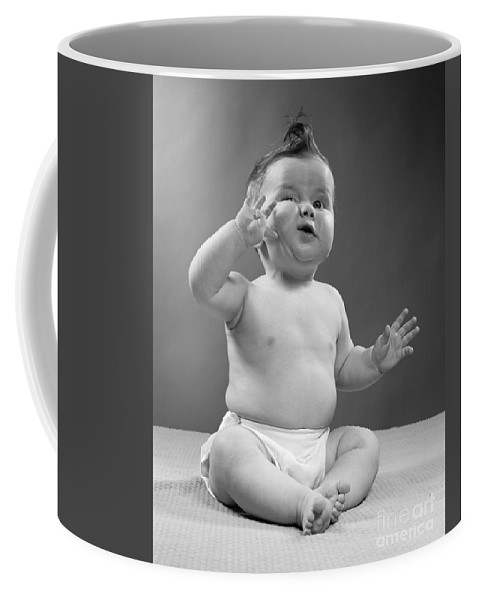 1950s Coffee Mug featuring the photograph Baby With Odd Expression, 1950s by H. Armstrong Roberts/ClassicStock