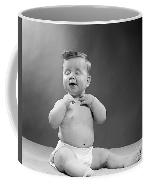 1950s Coffee Mug featuring the photograph Baby With Vain Expression, 1950s by H. Armstrong Roberts/ClassicStock