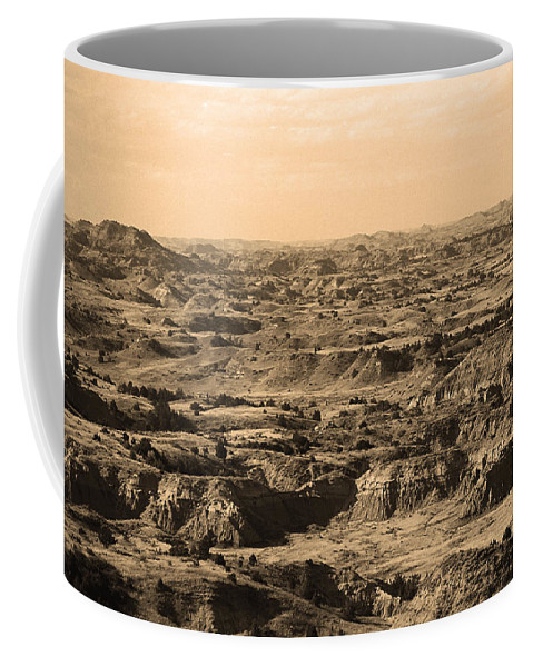 Art Coffee Mug featuring the photograph Badlands #3 Sepia by Frank Romeo