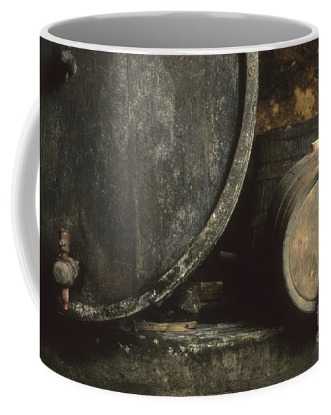 French Coffee Mug featuring the photograph Barrels Of Wine In A Wine Cellar. France by Bernard Jaubert