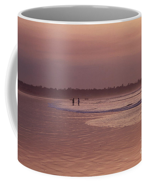 Ecuador Coffee Mug featuring the photograph Beachcombers by Kathy McClure