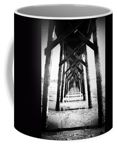 Pier Coffee Mug featuring the photograph Beneath The Pier by Tara Turner