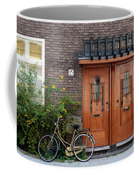 Bicycle Coffee Mug featuring the photograph Bicycle And Wooden Door by Thomas Marchessault