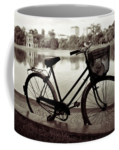 Bicycle Coffee Mug featuring the photograph Bicycle By The Lake by Dave Bowman