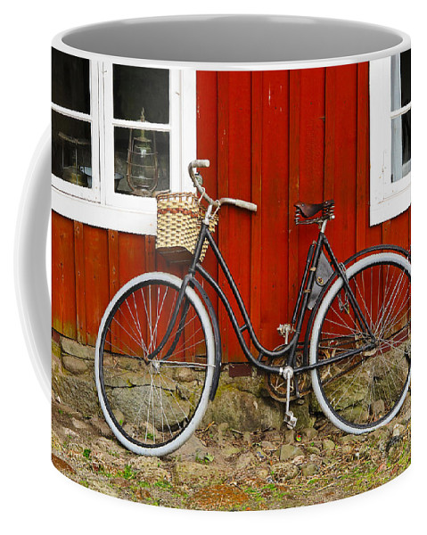 Bicycle Coffee Mug featuring the photograph Bicycle In Front Of Red House In Sweden by Greg Matchick