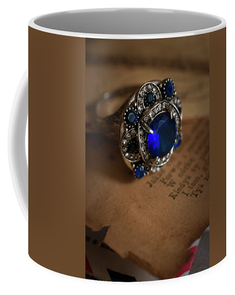 Ring Coffee Mug featuring the photograph Big Blue Ornamented Ring by Jaroslaw Blaminsky