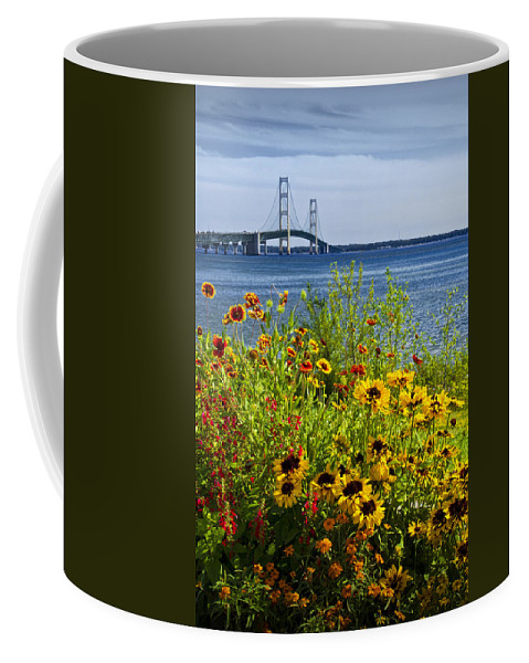 Michigan Coffee Mug featuring the photograph Blooming Flowers By The Bridge At The Straits Of Mackinac by Randall Nyhof