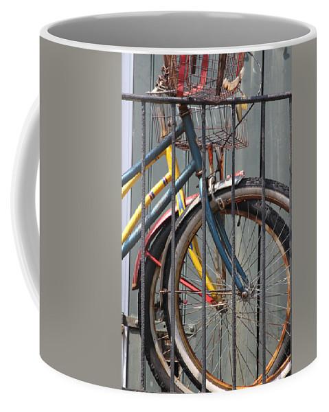 Bike Coffee Mug featuring the photograph Blue And Yellow Bikes by Lauri Novak
