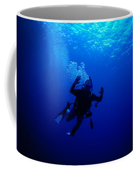 Mad Coffee Mug featuring the photograph Blue Diver by Michael Scott