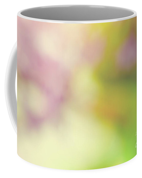 Blur Coffee Mug featuring the photograph Blurred Spring Nature Background by Michal Bednarek