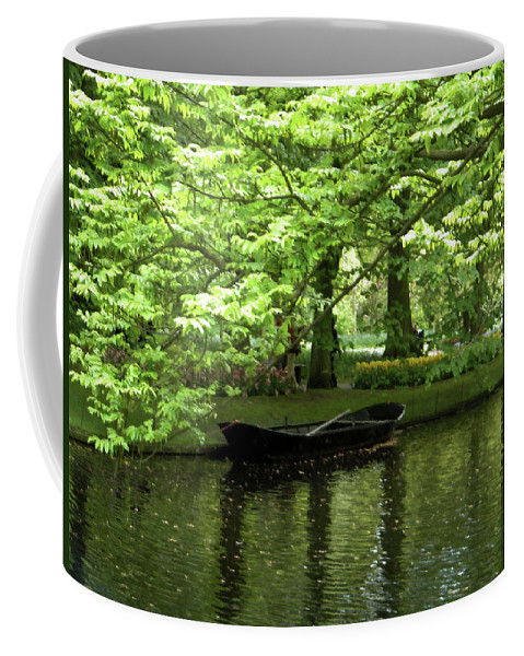 Boat Coffee Mug featuring the photograph Boat on a lake by Manuela Constantin