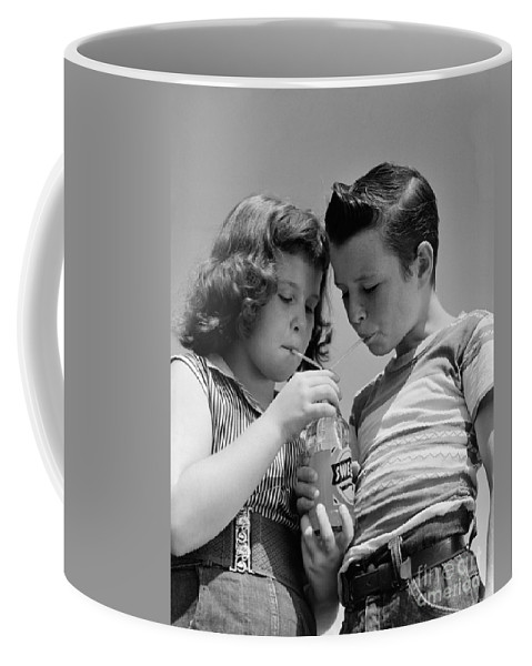 1950s Coffee Mug featuring the photograph Boy And Girl Sharing A Soda, C.1950s by H. Armstrong Roberts/ClassicStock