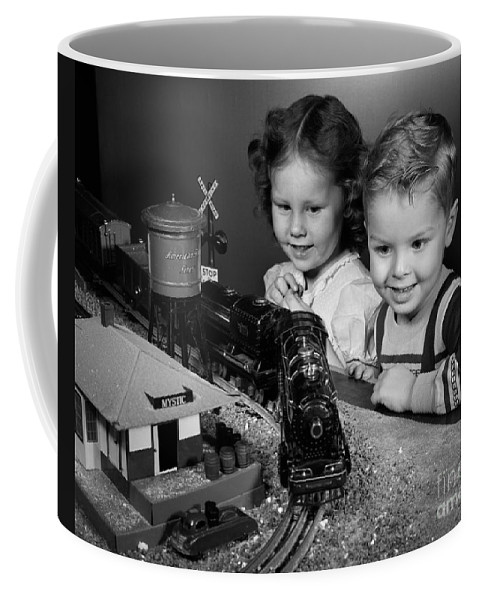 1950s Coffee Mug featuring the photograph Boy And Girl With Train Set, C.1950s by H. Armstrong Roberts/ClassicStock