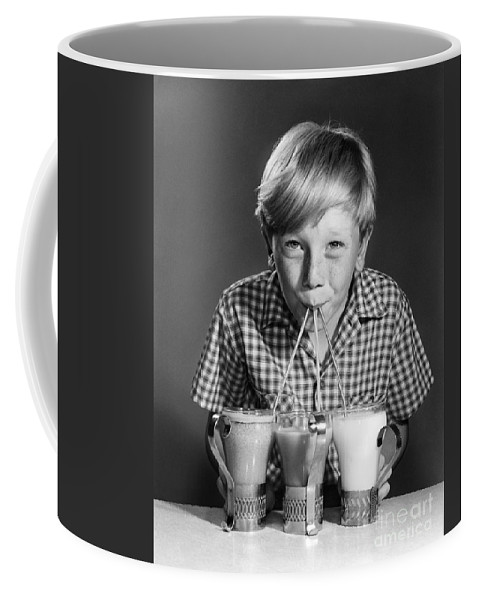 1950s Coffee Mug featuring the photograph Boy Drinking Three Shakes At Once by Debrocke/ClassicStock