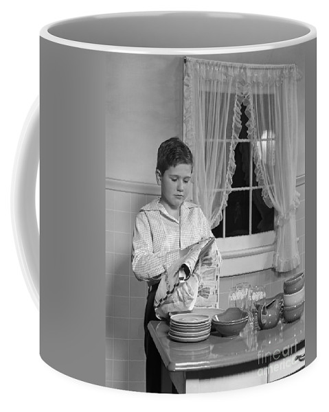 1950s Coffee Mug featuring the photograph Boy Drying Dishes, C.1950s by H. Armstrong Roberts/ClassicStock