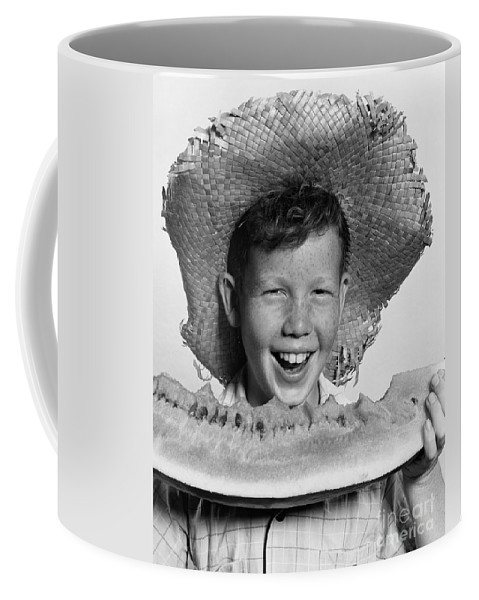 1940s Coffee Mug featuring the photograph Boy Eating Watermelon, C.1940-50s by H. Armstrong Roberts/ClassicStock