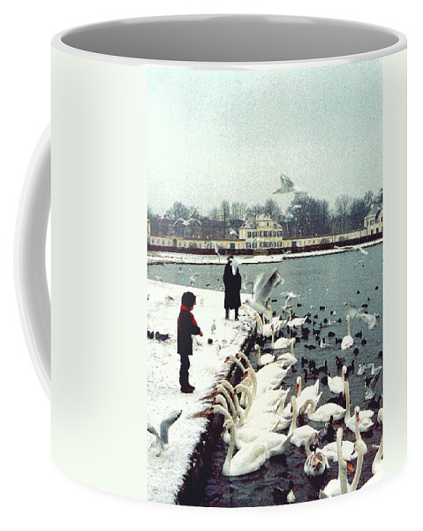 Swans Coffee Mug featuring the photograph Boy Feeding Swans- Germany by Nancy Mueller
