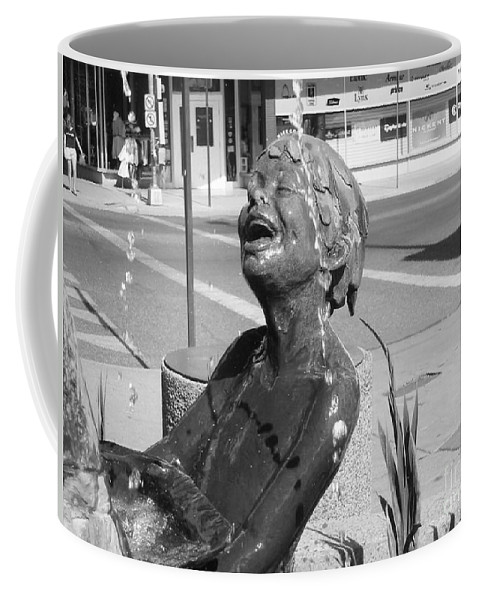 Boy In Fountain Sculture Coffee Mug featuring the photograph Boy In Fountain Sculture Grand Junction Co by Tommy Anderson
