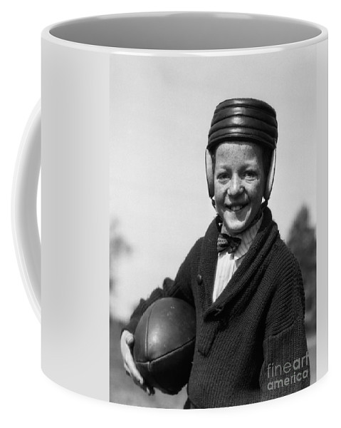 1920s Coffee Mug featuring the photograph Boy In Old-fashioined Football Gear by H. Armstrong Roberts/ClassicStock