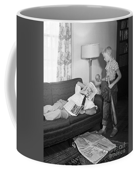 1950s Coffee Mug featuring the photograph Boy With Baseball Vs. Napping Dad by D. Corson/ClassicStock