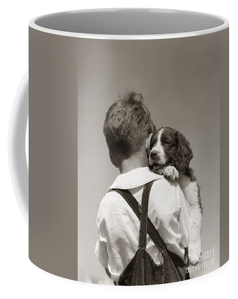 1930s Coffee Mug featuring the photograph Boy With Puppy, C.1930-40s by H Armstrong Roberts ClassicStock