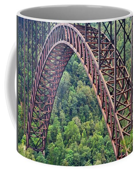 Landscape Coffee Mug featuring the photograph Bridge Of Trees by Rick Locke