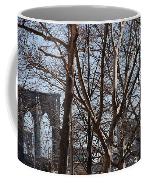 Architecture Coffee Mug featuring the photograph Brooklyn Bridge Thru The Trees by Rob Hans