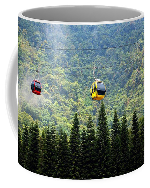 Cable-car Coffee Mug featuring the photograph Cable Car Passes By A Mountain Slope by Yali Shi